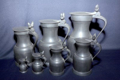 "Set of seven tin jugs ""Acorn"""